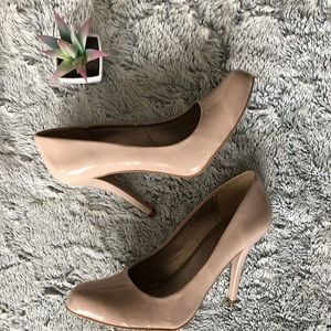 Nude pink patent pumps